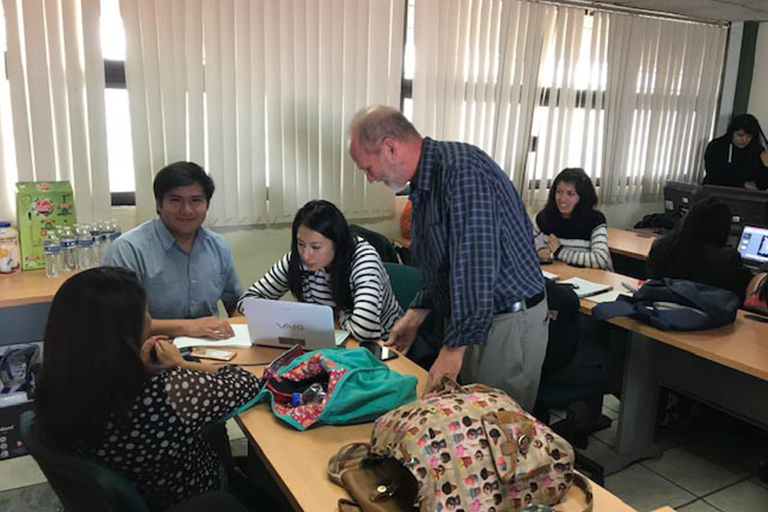 Students working with Dr. Mark Viner during the Consortium for North American Higher Education Faculty Exchange Program