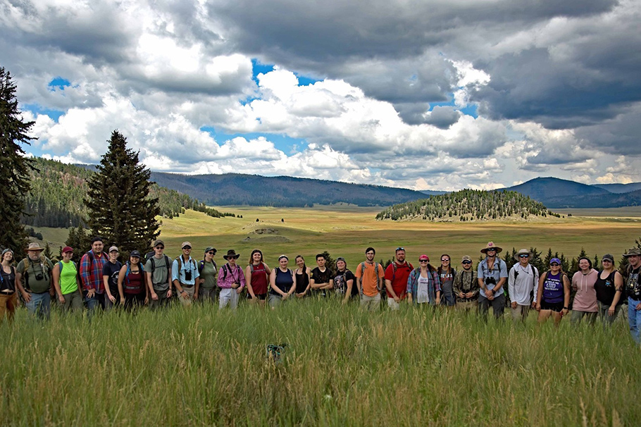 Laramie Mahan, pictured fifth from the left, with students from New Mexico and Tennessee at the Valles Caldera.