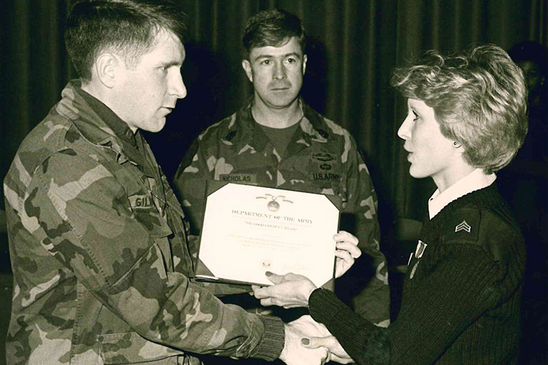 Gretchen Leigh, an executive secretary at ENMU, receiving one of five Army Achievement Medals.