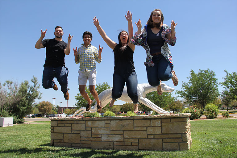 ENMU students jumping for joy