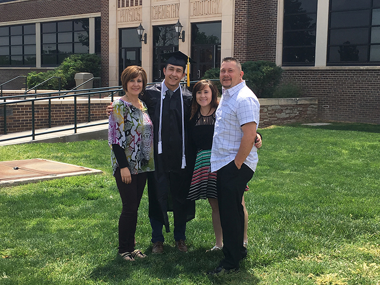 john garcia with family outside of science building