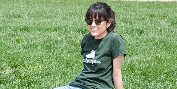 ENMU Student Sitting On Grass